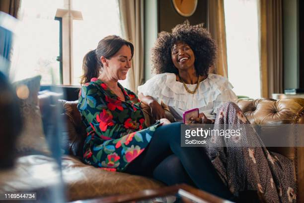 laughing at the weekend - female friendship stock pictures, royalty-free photos & images