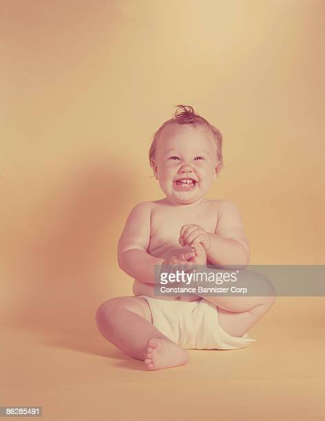 laughing baby - constance bannister stock photos and pictures
