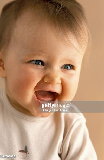 laughing baby - unknown gender stock pictures, royalty-free photos & images