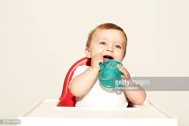 Laughing baby with water