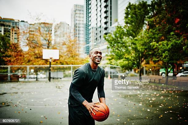 Laughing basketball player preparing to shoot