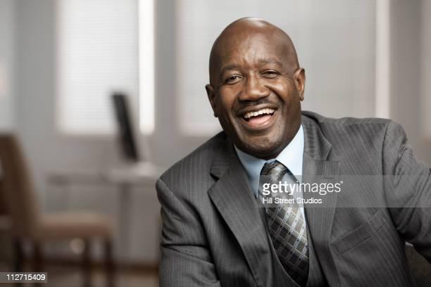 Laughing Black businessman