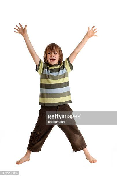 Laughing boy standing with arms and legs spreaded