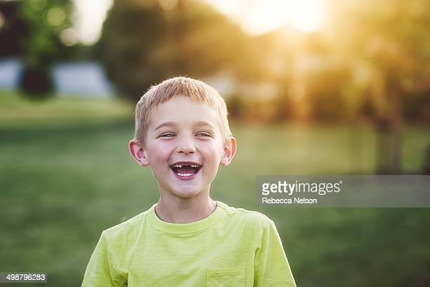 Laughing boy with toothless grin