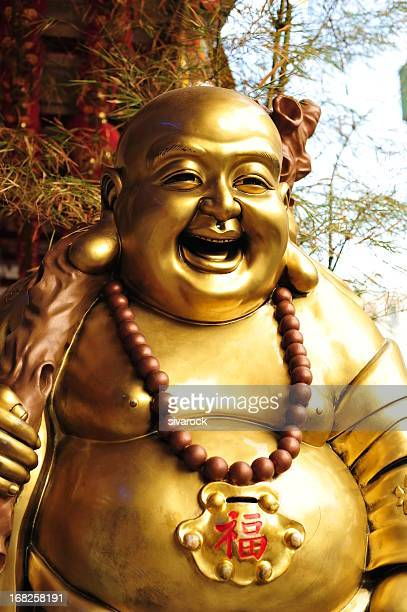 laughing buddha - buddha stock photos and pictures