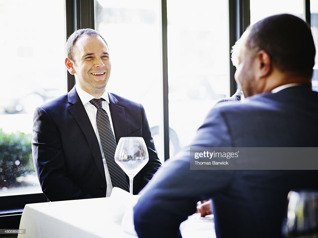 Laughing businessman in lunch meeting with client : Foto de stock