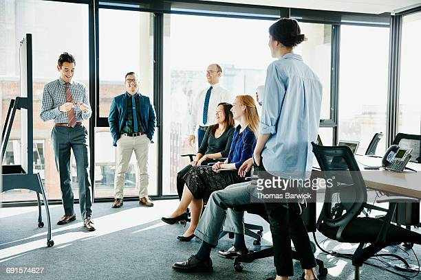 Laughing businessman leading team meeting