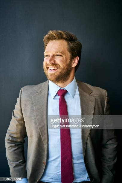 laughing businessman standing in front of a black background - one man only stock pictures, royalty-free photos & images