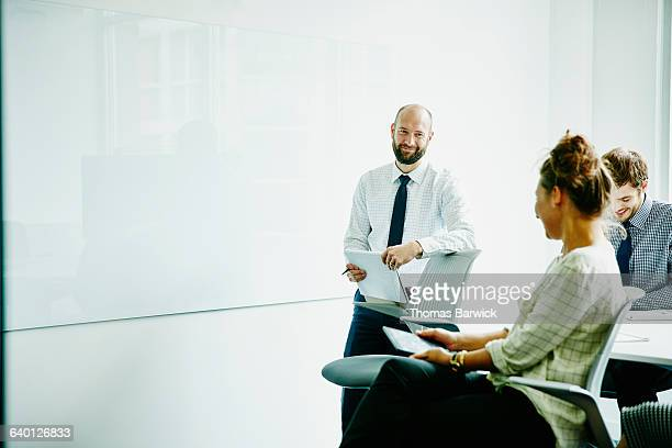 Laughing businesspeople in meeting in office