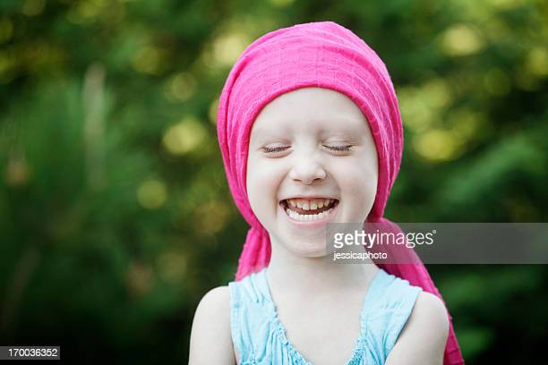 laughing chemo child - bald girl stock photos and pictures