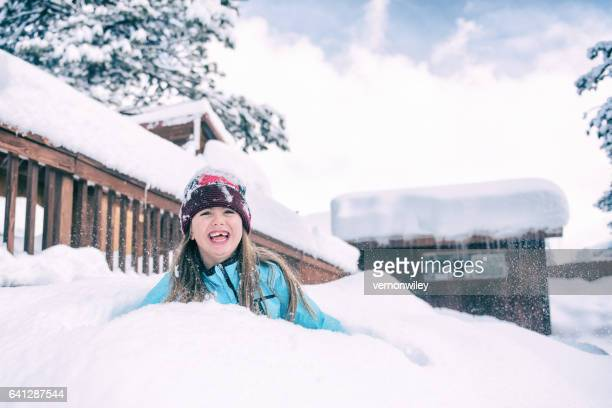 laughing child buried in snow - buried stock pictures, royalty-free photos & images