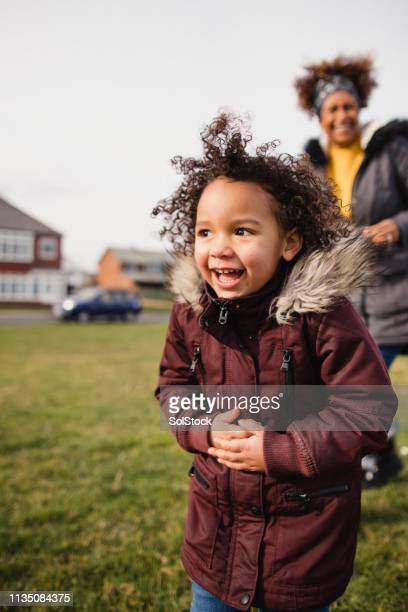 laughing child - real people stock pictures, royalty-free photos & images