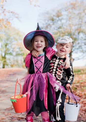 Laughing children in Halloween costumes - gettyimageskorea
