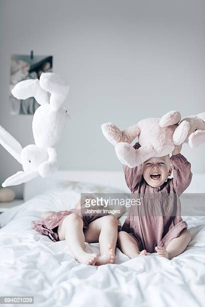 laughing children on bed - soft toy stock pictures, royalty-free photos & images