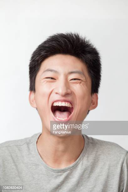 laughing chinese man - mouth open stock pictures, royalty-free photos & images