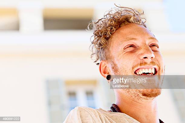 Laughing cool young man outdoors