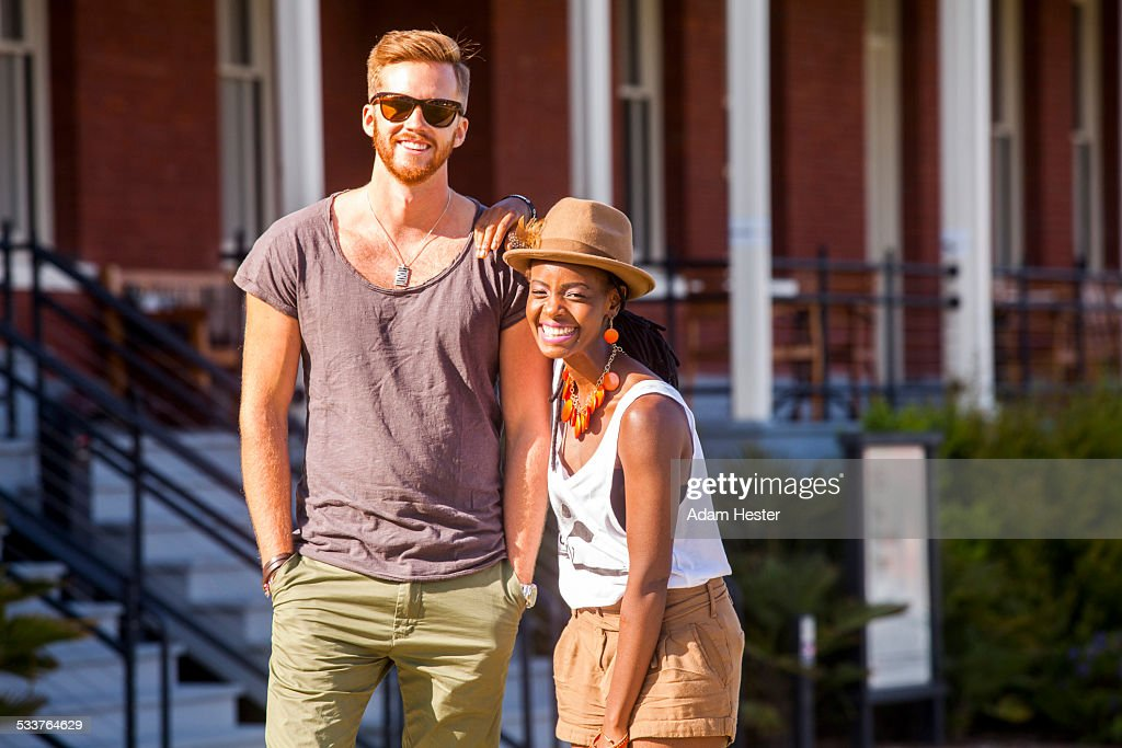 Laughing couple walking outdoors : Foto stock
