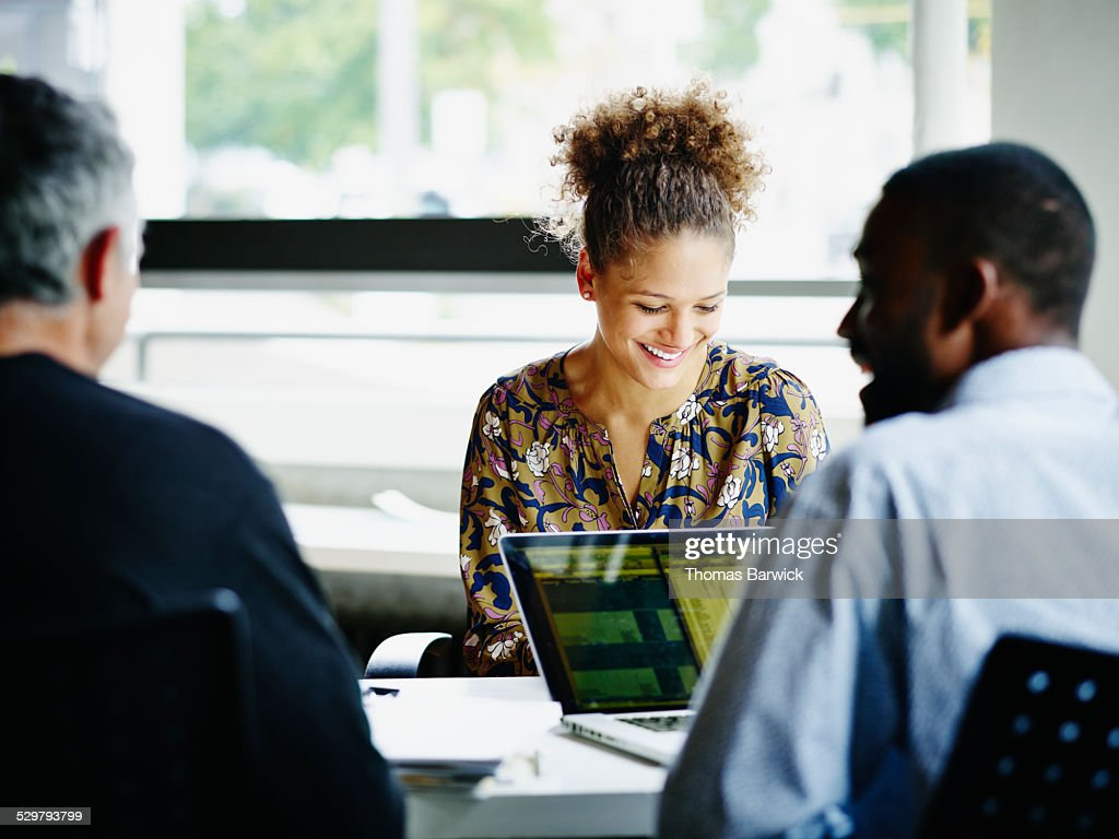 Laughing coworkers in informal meeting in office : Stock Photo