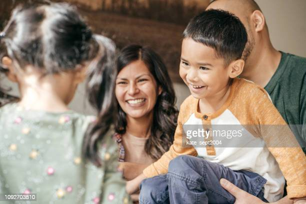 laughing family with two kids - filipino family stock pictures, royalty-free photos & images