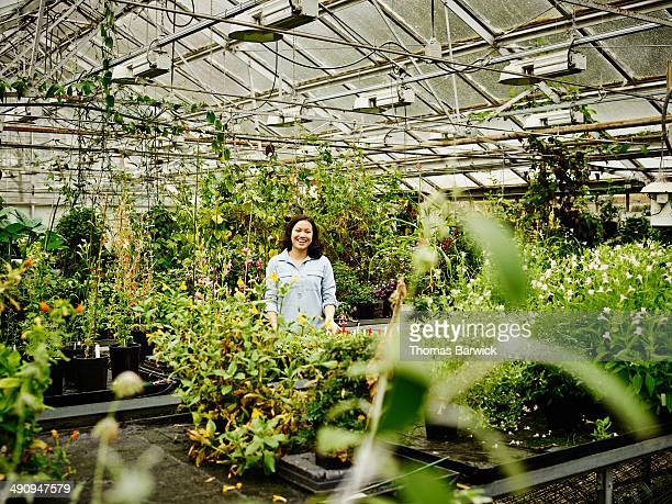Laughing female botanist in research greenhouse