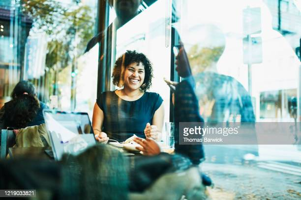 laughing female business colleagues having lunch in restaurant - differential focus stock pictures, royalty-free photos & images