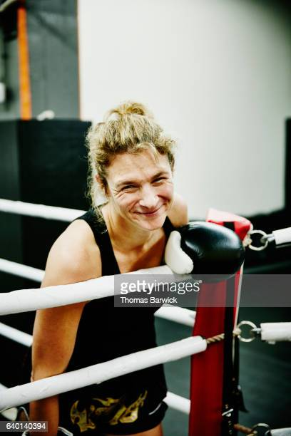 laughing female kickboxer training in ring in gym - ボクシングリング ストックフォトと画像