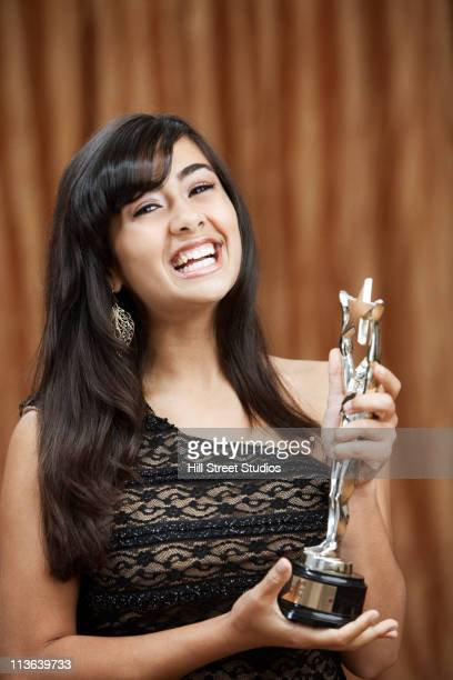 laughing filipino teenage girl holding trophy - gardena california stock pictures, royalty-free photos & images
