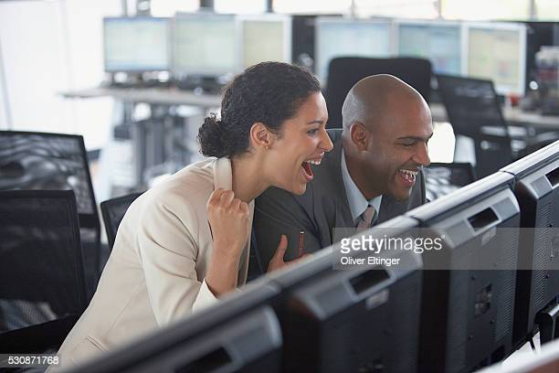 Laughing financial traders