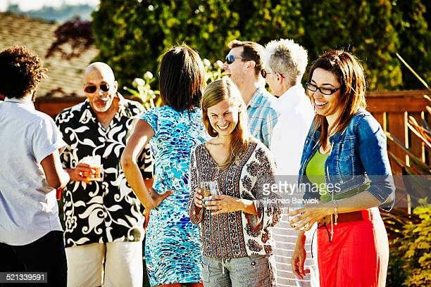 Laughing friends at party in backyard