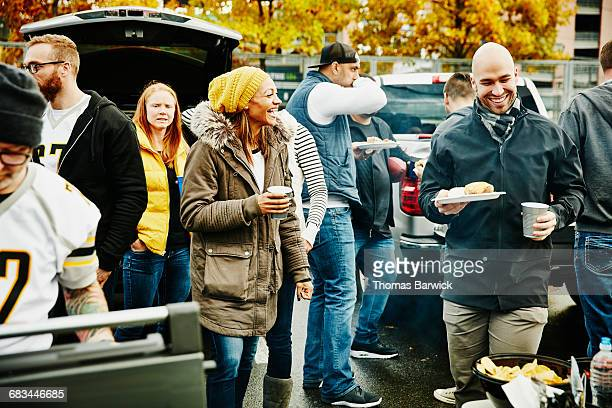 Laughing friends at tailgating party