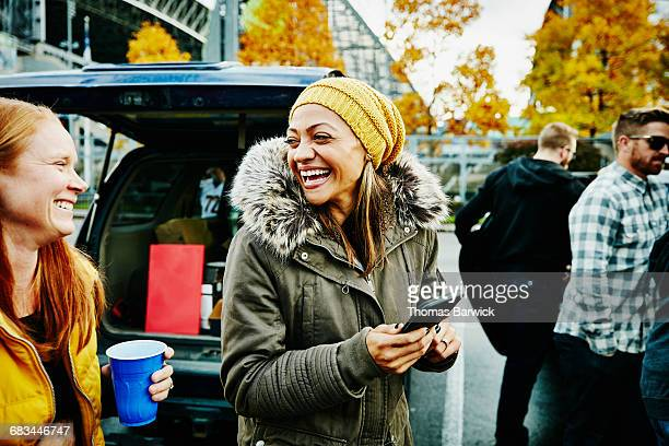 laughing friends at tailgating party - tailgate party stock pictures, royalty-free photos & images