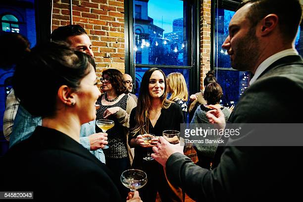 laughing friends having drinks during dinner party - party social event stock pictures, royalty-free photos & images