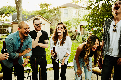 Laughing  friends in backyard on summer evening - gettyimageskorea