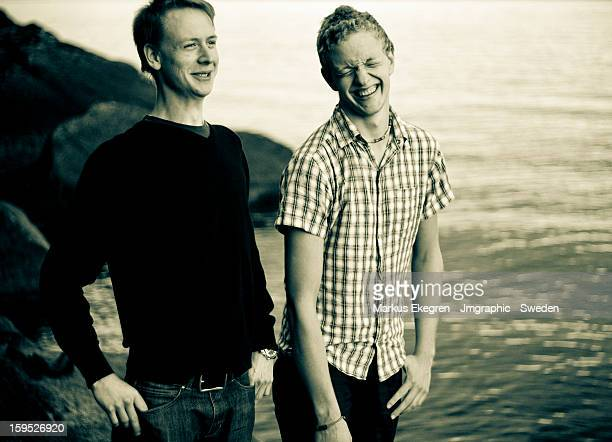laughing friends - only young men stock pictures, royalty-free photos & images