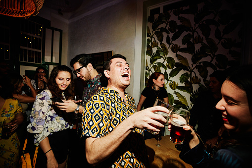 Laughing friends toasting during party in night club - gettyimageskorea
