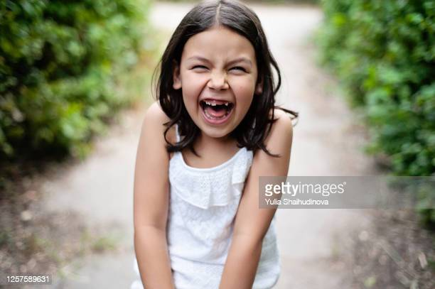 laughing girl close-up portrait. 7 years age girl with no tooth - 6 7 years stock pictures, royalty-free photos & images