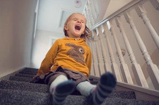 Laughing girl (4-5) having fun sliding down carpeted stairs - gettyimageskorea