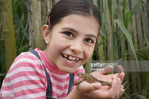 Laughing Girl Holding Frog