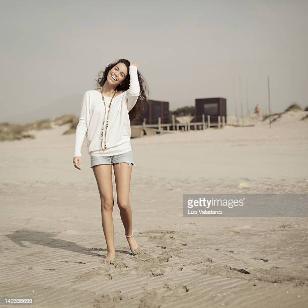 Laughing girl on beach