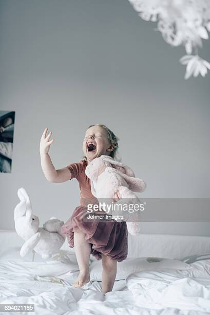 Laughing girl on bed