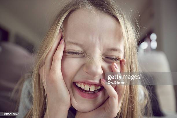 laughing girl (9-10) - innocence stock pictures, royalty-free photos & images