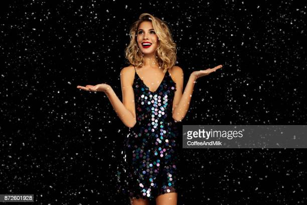 laughing girl with falling snow - christmas party stock photos and pictures