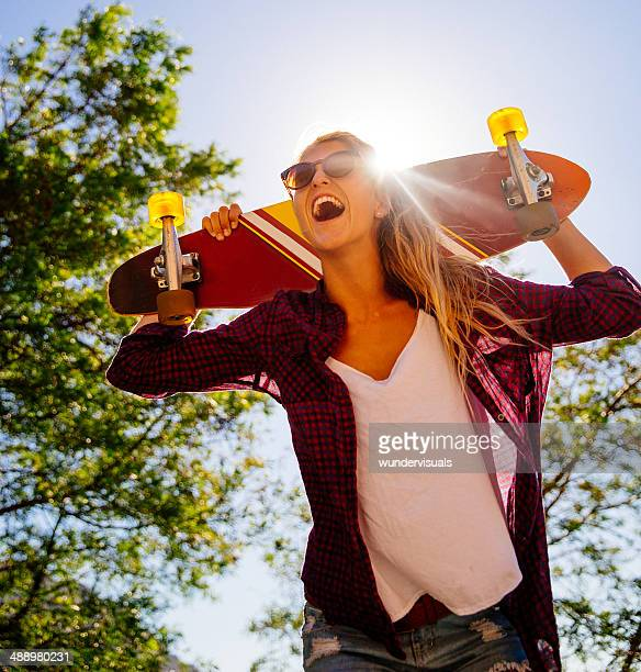 Laughing girl with skateboard