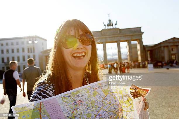 Laughing girl with street map