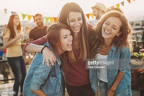 laughing girlfriends on a party - chica borracha fotografías e imágenes de stock