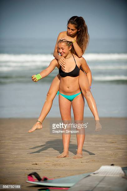 laughing girls doing 'selfies' on the beach