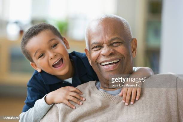 Laughing grandfather and grandson