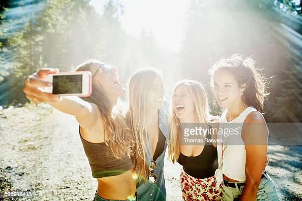 Laughing group of friends taking self portrait