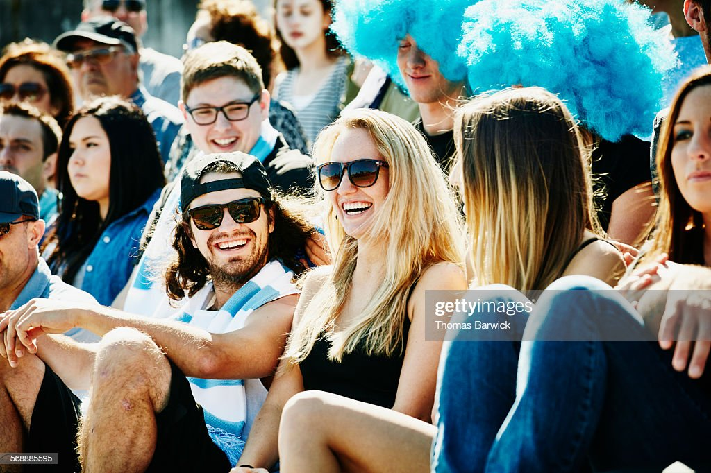 Laughing group of friends watching soccer match : Stock Photo