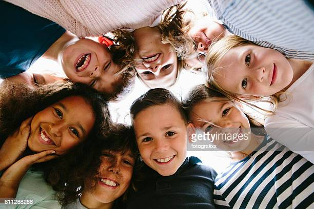 laughing group of kids in circle